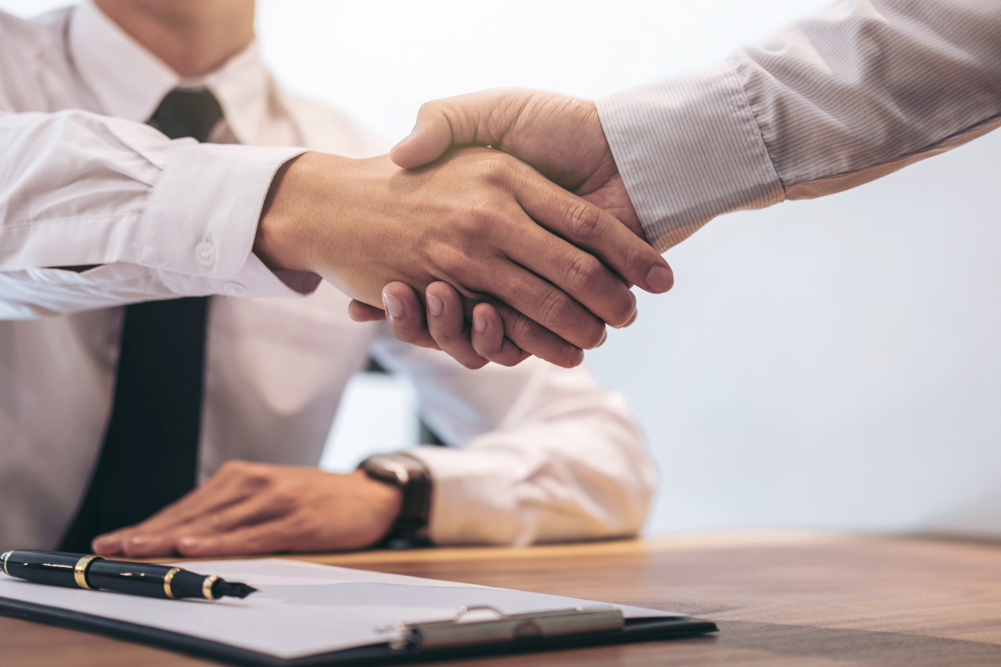 man shaking hands with insurance broker